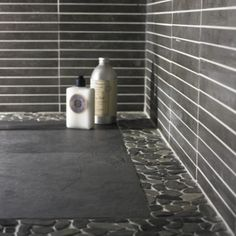 Use flat pebble mosaic tile to create a border for your shower floor. #MosaicMonday #TileSensations