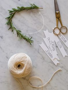 DIY Rosemary Wreath Place Cards tutorial from - This project is really simple. All you need are rosemary sprigs, floral wire, scissors, and twine. Christmas Place Cards, Christmas Names, Christmas Table Settings, Christmas Crafts, Christmas Decorations, Xmas, Christmas Presents, Diy Place Cards, Name Place Cards