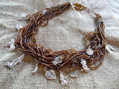 Brown Beaded Multi Strand Necklace with Silver Milagros Approximately 12 inches (30 centimeters)   #milagro #milagros #altars #altar #miracle #charm #charmed #blessed #divine #mexico #saints #mexican #custom #blessing #art #handmade #sacred #faith #god #style #amulet #talisman #angel #protection #prayer #chic #fashion #jewelry #silver #necklace  Segundo Milagro  Want One?  gringagordon@gmail.com
