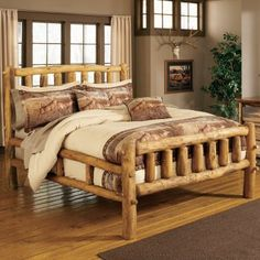 wooden bed.Hopefully one day I can have a bed like this in my own winter/summer cabin