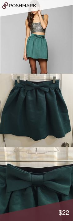 Kimchi Blue bow skirt in real Purchased from urban outfitters, teal bow skirt. Material is 100% polyester. Size M but fits more like a small IMO. In perfect condition. Kimchi Blue Skirts