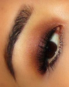 burgundy smokey eye with glitter on the bottom lash line <3