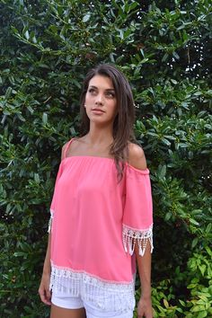 We love the trim on this bright pink top!
