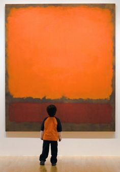 A child looking at a Mark Rothko painting