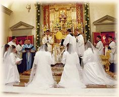 Sisters Adorers of the Royal Heart of Jesus Postulants taking their vows