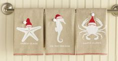 SEAson Greetings Towel. Add a whimsical beach element to the bath or kitchen. Linen hand towel with blanket stitching detail and santa hat applique.