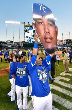 Kansas City Royals' Salvador Perez walks around with a big head of himself after the teams 2-1 win over the Baltimore Orioles following Wednesday's ALCS baseball game on October 15, 2014 at Kauffman Stadium in Kansas City, Mo.