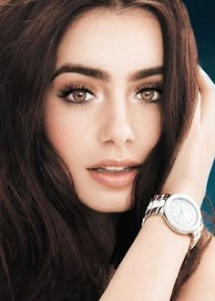 Lily Collins. I have to get hazel or honey colored contacts