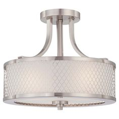 Metal semi-flush mount in brushed nickel with latticework overlay and an interior drum shade.   Product: Semi-flush mount