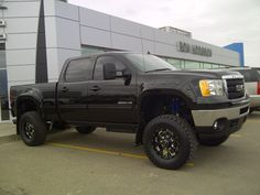 """2012 GMC SIERRA CREW CAB 2500 4WD STANDARD BOX-- Built for Wesley M this is how it's decked out-- We start out with a FabTech 6"""" RTS Suspension Lift. Add BMF Novakane 18"""" wheels wrapped in Dick Cepek FCll rubber. We installed Bushwacker Pocket Flares and Action Kick Back Flaps to protect this Black Beauty. Bestop Power Boards help Wes climb into the cab. To gain a little more HP we added an AFE Cold Air Intake and Banks Exhaust. Front windows are tinted to complete the look. Congrats Wes!"""