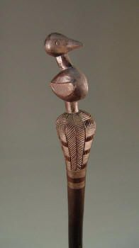 African Staff similar to Kojo's in Saltwater Lover. The bird form is often found on status objects, such as chief thrones and figurative combs.