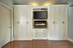 Beautiful wall unit, Antique White with bronze pulls. Featuring media center and electric fireplace! http://www.spacesolutions.ca/builtins.php