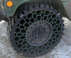 Resilient Technologies, LLC has designed a non-Pneumatic tire or an NPT, which looks like a circle of honeycombs.  If and when shrapnel hit the tyre there would be ample space for it to pass through and not damage the tires.