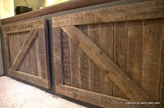 DIY_barn_doors_hanging  Love these for an outdoor TV cabinet.  I will finally get to use my pallet wood:).