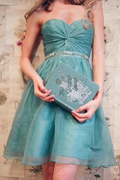 Can you believe this teal number is a bridesmaids dress!  I would definitely re-wear it! kissthegroom.com