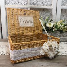 Nice idea - decorated basket for guests to pop their wedding cards into.
