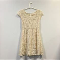Cream Lace Dress Gorgeous cream short-sleeved lace dress with sheer shoulders. Only worn once. Great condition! Monteau Dresses