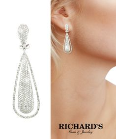 Pave diamond drop earrings in 14k white gold.