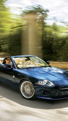 ♂ Blue convertible car Jaguar XK Cabriolet -- Curated by: Williams Automotive | 1790 KLO Rd. Kelowna | 250-860 2812