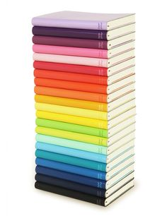 holy moly! look at that stack of colorful leatherbound journals!