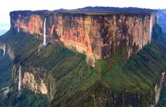 "Mount Roraima, Venezuela in Venezuela. The highest point of the mountain is ""El Maverick"", 2810 m, at the southern end of the plateau and totally inside Venezuela. Part of it is in Guyana and Brasil but is in Venezuela. Monte Roraima, Places To Travel, Places To See, Places Around The World, Around The Worlds, Les Cascades, The Lost World, Natural Wonders, Wonders Of The World"