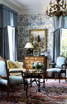 Blue and cream toile wallpaper, oriental rug, dog painting, large brass or bronze chandelierjd