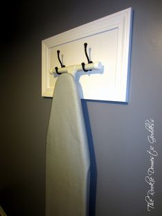 Ironing Board Hanger - use the drawer fronts that you've been hiding in Mom's basement all this time.