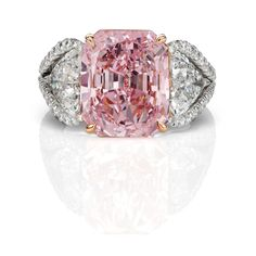 An amazing carat pink diamond set with two trilliant side stones and pave halos, one of the most glamorous pink diamond rings in the world Pink Diamond Engagement Ring, Pink Diamond Ring, Pink Sapphire, Engagement Rings, Sapphire Gemstone, Gemstone Rings, Pink Diamonds, Wedding Engagement, Gold Jewelry