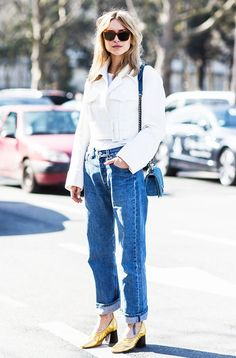 Pernille Teisbaek layers a plain white tee underneath a white cropped jacket, tucked into a pair of boyfriend jeans and a pair of metallic heels for a girly finish Fashion Week, Winter Fashion, Fashion Trends, Paris Fashion, Cozy Fashion, Who What Wear, Boyfriend Jeans, Celine, Capsule Wardrobe Mom