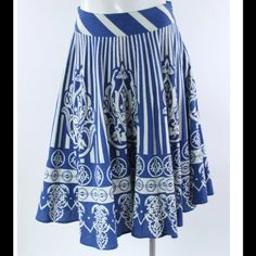 "Stripped Baroque Print Cotton Full A-Line Skirt Condition: A few small pulls throughout, minor discoloration at waistband.   Details: Size 2 85% Cotton 15% Linen Blue and White Striped and Baroque Pattern  A-Line, Below the Knee Side Zip Fully Lined   Flat Measurements: Waist: 14"" Length: 26"" Maple Skirts A-Line or Full"