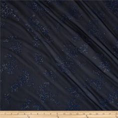 Glitter Chiffon Knit Floral Navy from @fabricdotcom  This elegant chiffon knit fabric is sheer, has a beautiful hand, drape and has 25% stretch across the grain for added comfort and ease. It is perfect for making stylish evening gowns, blouses, scarves, overlays and costumes. Fabric features glitter adhered to the face of the fabric.