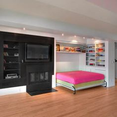 murphy bed for basement I really like this idea. Keeps a open floor when you don't need the bed.