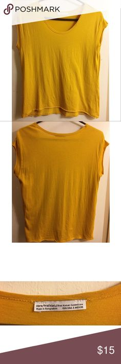 ZARA MUSTARD YELLOW CROP TEE Size small. Excellent pre-owned condition. Cropped tee by ZARA. Super soft, raw hems/edges. Slightly oversized - loose fit. Size small. No visible flaws or stains. Please view photos and ask questions before purchase. NO Trades. BUNDLE discount on 2 or more items. Thanks and happy poshing ! Zara Tops Tees - Short Sleeve