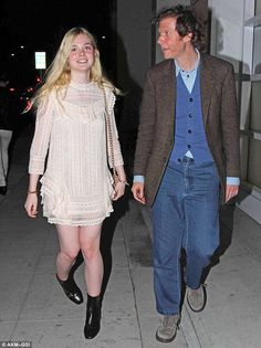 Pretty as a picture: Showcasing her signature quirky style, the 15-year-old actress looked completely ahead of the fashion game in a cream vintage number as she grabbed a bite to eat with her dad, Stephen, at Mr. Chow in Beverly Hills