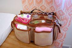 A $3 thrift store camera bag makes the best diaper bag ever. | 33 Genius Hacks Guaranteed To Make A Parent's Job Easier