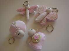 Beautiful Bugs & Butterflies! - felt & fabric... cute keychains! [also could use clothespins and clay and pal them up with some potted plants... stick them on garden stakes, or just dangle them from small tree branches - sweet little somethin'-somethin' somewhere!]