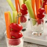 go-to appetizer is homemade dill dip served with carrot and celery sticks and cherry tomatoes. Serving them up in individual shot glasses offers a little visual interest, and its grab-and-go portability makes them perfect for mingling.