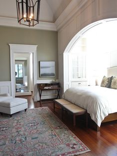 """masculine bedroom features a king bed with upholstered headboard and wooden rails and""""  """"Desk from British Khaki. They are to the trade and through showrooms across the country. Good luck!""""  """"master bedroom condo""""  """"For hidden doors in bedroom""""  """"Master bedroom? :)...Master bedroom...Guest Bedroom 1"""""""