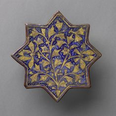 Star-shaped tile with a stylized flowering plant, anonymous, c. 1250 - c.