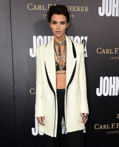 """From the cast, actress Ruby Rose poses on arrival for the premiere of the film """"John Wick Chapter Two"""" in Hollywood, California on January 30, 2017. / AFP / Frederic J. Brown"""