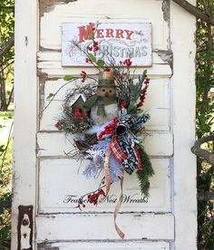 This Small Christmas Wreath is Made on a Grapevine Base that has a Pocket to it. I have Added a Rustic Sparkly Snowman, Winter Berry Twigs, Red Berries, and Pine. I Finished it out with a Wired Christmas Plaid, Merry Christmas Ribbon Trim, a Wired Christmas Chalkboard Style Christmas Wreaths For Front Door, Christmas Ribbon, Plaid Christmas, Merry Christmas, Christmas Floral Designs, Christmas Chalkboard, Snowman Wreath, Winter Project, Red Berries