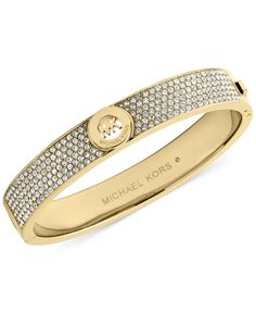 A name in lights. A bold logo design is surrounded by sparkling crystal pave on this Michael Kors bangle bracelet. Crafted in rose gold-tone, gold-tone or silver-tone steel. Michael Kors Armband, Michael Kors Schmuck, Michael Kors Bracelet, Michael Kors Jewelry, Gold Bangle Bracelet, Cartier Love Bracelet, Jewelry Bracelets, Jewelry Watches, Bangles