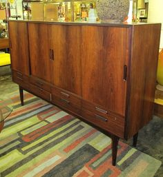 Awesome 1960s Danish Modern rosewood sliding door tall sideboard fitted with lots of slide-out drawers for storage.