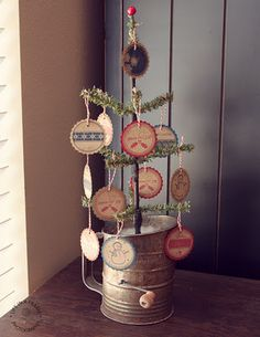 "Oh how cute - I just ""planted"" a Christmas tree in an old sifter today.... need to consider adding a few decorations on the tree now... :)"