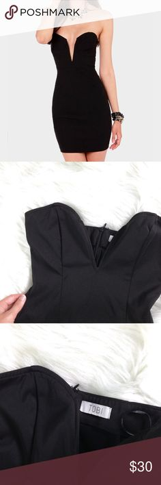 Plunging Black Dress A perfect little black dress with abc cut neckline, from Tobi size Small but fits XS. Perfect condition. Hidden zipper in the back. Tobi Dresses Strapless