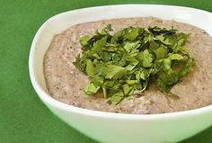 Black Bean Hummus  1 (15 oz.) can black beans, drained   3 Tbsp. tahini   1/4 cup fresh cilantro, packed   1/2 cup onion (yellow or white)   2 cloves garlic, peeled and smashed   1 Tbsp. olive oil   2 Tbsp. lemon or lime juice   1 tsp. cumin   1/4 tsp. cayenne pepper (optional)   pinch of salt and pepper, to taste