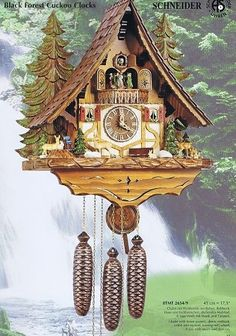 Model #8TMT 2654/9 Curved Roof Chalet Cuckoo Clock with Forest Scenery.