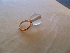 CHEAPLY PRICED.  $11.50 Canadian.   FREE NECKLACE GIFT WITH EVERY PURCHASE. Gold-plated adjustable ring. This ring has a large and chunky glass setting and is accented with an acrylic crystal which sits at very top of ring. Glass bead setting measures is 20mm. https://www.etsy.com/ca/shop/JehovahJJewellery?ref=si_shop