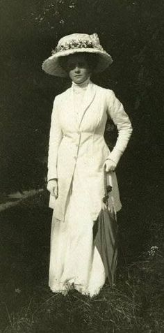 White walking suit and hat.