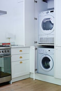 HIdden washer and dryer in kitchen of Isabel and George Blunden London renovation